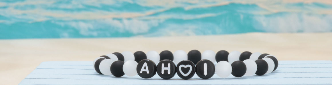 Buchstabenperlen, rund und schwarz